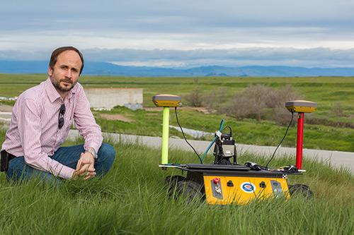 Professor Stefano Carpin and one of his robots
