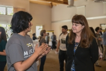 Tamara Jernigan, veteran of five NASA space flights (left) speaks with a MACES participant.